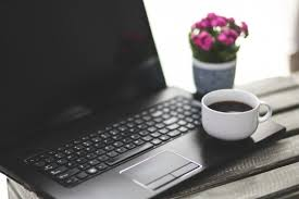 cup and laptop